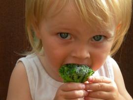 child eating broccoli july 20