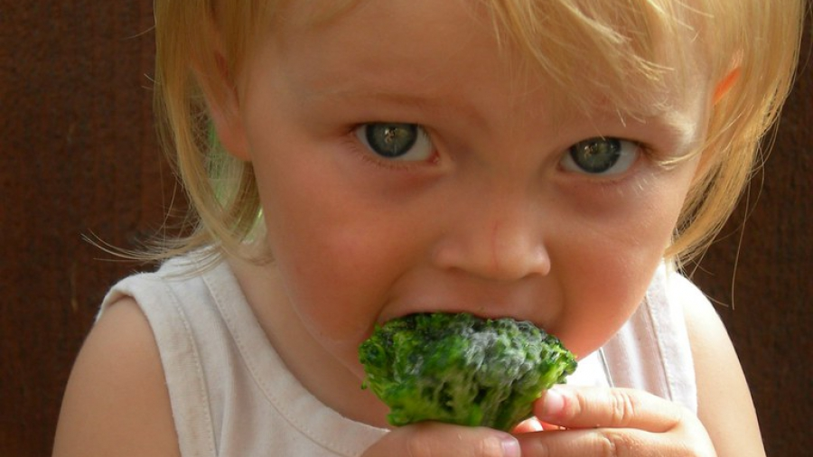 child eating broccoli july 20